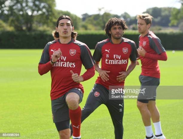 Hector Bellerin and Mohamed Elneny of Arsenal during a training session at London Colney on August 18 2017 in St Albans England