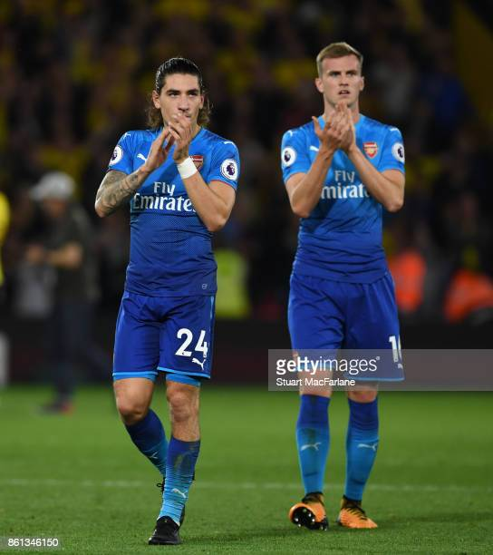 Hector Bellerin and Rob Holding applaud the Arsenal fans after the Premier League match between Watford and Arsenal at Vicarage Road on October 14...