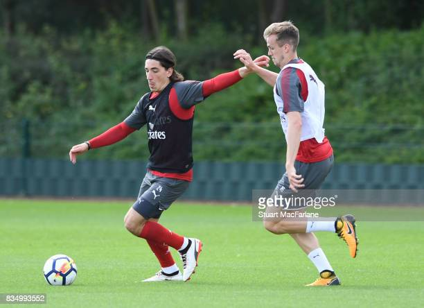 Hector Bellerin and Rob Holding of Arsenal during a training session at London Colney on August 18 2017 in St Albans England