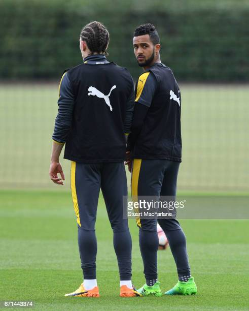 Hector Bellerin and Theo Walcott of Arsenal during a training session at London Colney on April 22 2017 in St Albans England