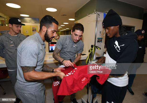 Hector Bellerin and Theo Walcott visit the Teenage Cancer Trust Unit in University College Hospital on December 5 2017 in London England