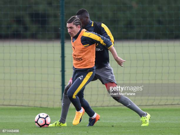 Hector Bellerin and Yaya Sanogo of Arsenal during a training session at London Colney on April 22 2017 in St Albans England
