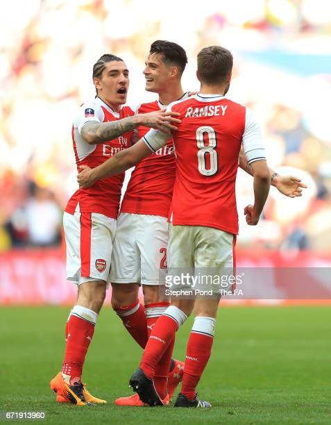 Hector Bellerin Granit Xhaka and Aaron Ramsey of Arsenal celebrate their 21 victory after the Emirates FA Cup SemiFinal match between Arsenal and...