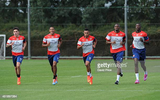 Hector Bellerin Isaac Hayden Francis Coquelin Abou Diaby and Yaya Sanogo of Arsenal during a training session at London Colney on July 9 2014 in St...