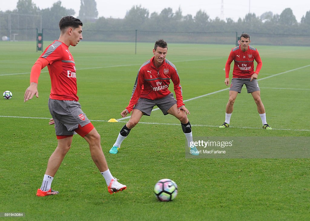 Hector Bellerin Laurent Koscielny and Granit Xhaka of Arsenal during a training session at London Colney on August 19 2016 in St Albans England