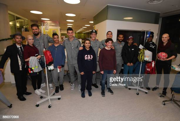 Hector Bellerin Laurent Koscielny Mesut Ozil Olivier Giroud and Theo Walcott visit the Teenage Cancer Trust Unit in University College Hospital on...