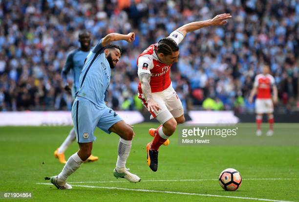 Hector Bellerin of Arsenal and Gael Clichy of Manchester City compete for the ball during the Emirates FA Cup SemiFinal match between Arsenal and...