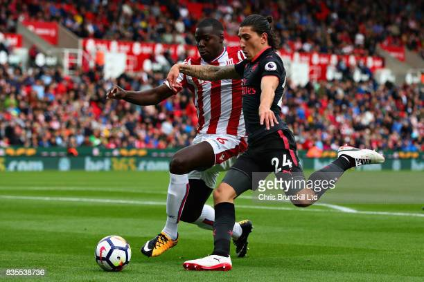 Hector Bellerin of Arsenal and Kurt Zouma of Stoke City in action during the Premier League match between Stoke City and Arsenal at Bet365 Stadium on...