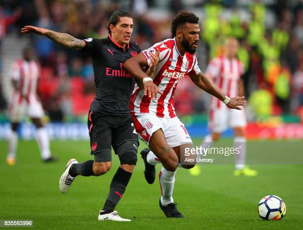 Hector Bellerin of Arsenal and Maxim ChoupoMoting of Stoke City battle for possession during the Premier League match between Stoke City and Arsenal...