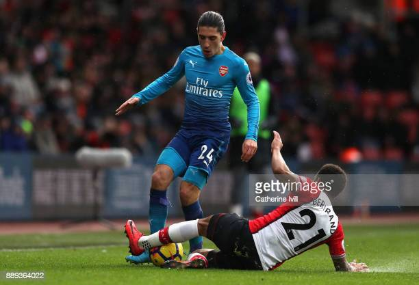Hector Bellerin of Arsenal and Ryan Bertrand of Southampton clash during the Premier League match between Southampton and Arsenal at St Mary's...