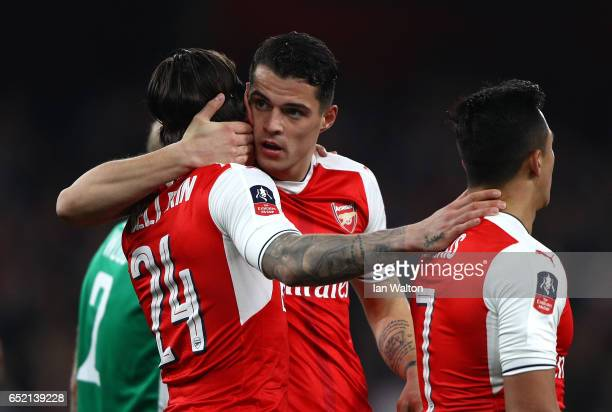 Hector Bellerin of Arsenal celebrates scoring his sides second goal with Granit Xhaka of Arsenal during The Emirates FA Cup QuarterFinal match...