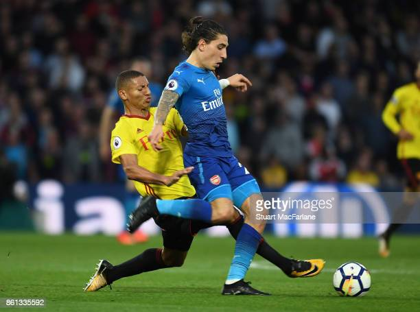 Hector Bellerin of Arsenal challenged by Richarlison of Watford during the Premier League match between Watford and Arsenal at Vicarage Road on...