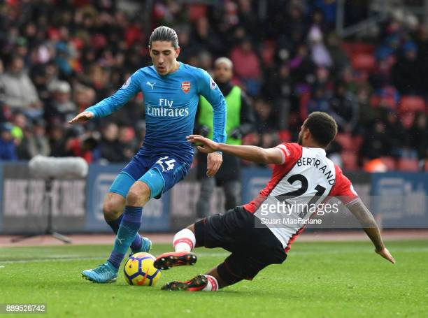 Hector Bellerin of Arsenal challenged by Ryan Bertrand of Southampton during the Premier League match between Southampton and Arsenal at St Mary's...