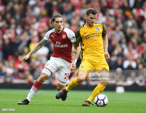 Hector Bellerin of Arsenal challenges Pascal Gross of Brighton during the Premier League match between Arsenal and Brighton and Hove Albion at...