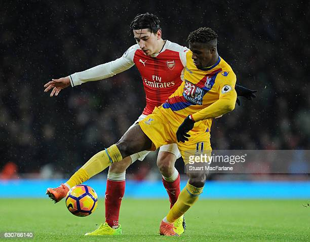 Hector Bellerin of Arsenal challenges Wilfred Zaha of Crystal Palace during the Premier League match between Arsenal and Crystal Palace at Emirates...