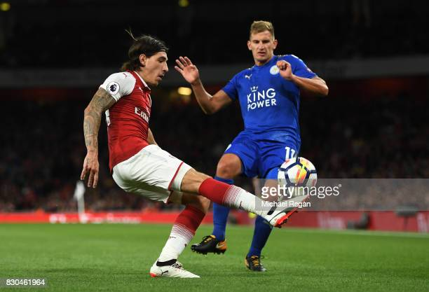 Hector Bellerin of Arsenal clears the ball as Marc Albrighton of Leicester City closes in during the Premier League match between Arsenal and...