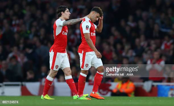 Hector Bellerin of Arsenal consoles Alex OxladeChamberlain of Arsenal as he goes off injured during The Emirates FA Cup QuarterFinal match between...