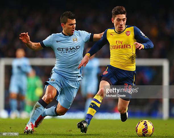 Hector Bellerin of Arsenal evades Sergio Aguero of Manchester City during the Barclays Premier League match between Manchester City and Arsenal at...