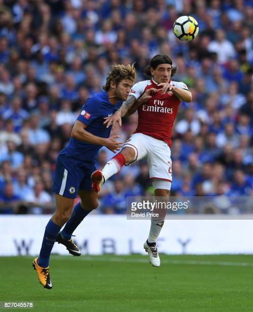 Hector Bellerin of Arsenal heads the ball under pressure from Marcos Alonso of Chelsea during the match between Chelsea and Arsenal at Wembley...