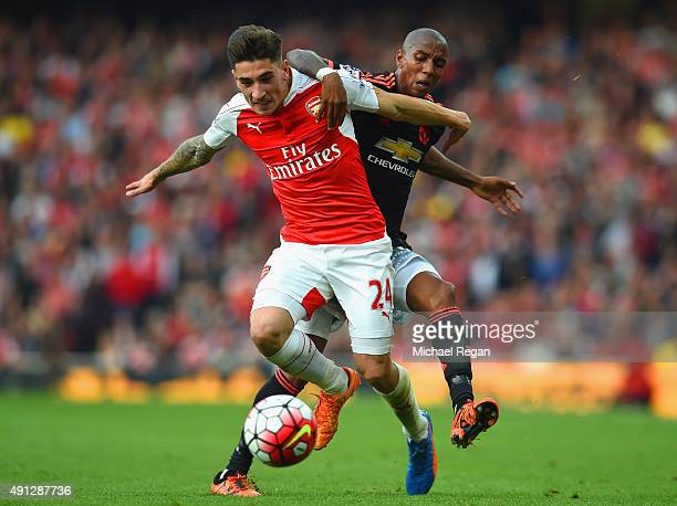 Hector Bellerin of Arsenal holds off Ashley Young of Manchester United during the Barclays Premier League match between Arsenal and Manchester United...