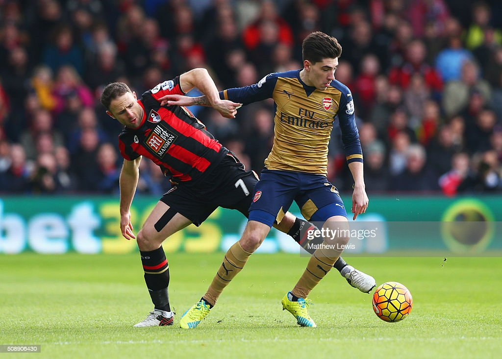 Hector Bellerin of Arsenal holds off <a gi-track='captionPersonalityLinkClicked' href=/galleries/search?phrase=Marc+Pugh&family=editorial&specificpeople=5831744 ng-click='$event.stopPropagation()'>Marc Pugh</a> of Bournemouth during the Barclays Premier League match between A.F.C. Bournemouth and Arsenal at the Vitality Stadium on February 7, 2016 in Bournemouth, England.