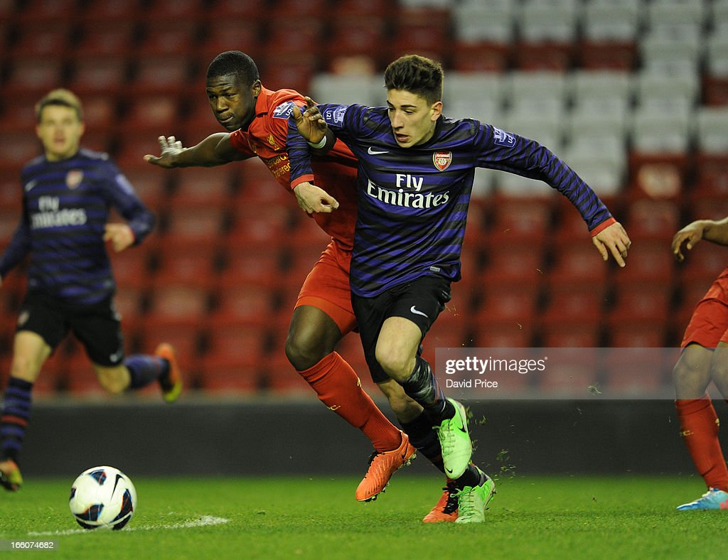 Hector Bellerin of Arsenal holds off Stephen Sama of Liverpool during the Barclays Under-21 League match between Liverpool U21 and Arsenal U21 at Anfield on April 08, 2013 in Liverpool, England.