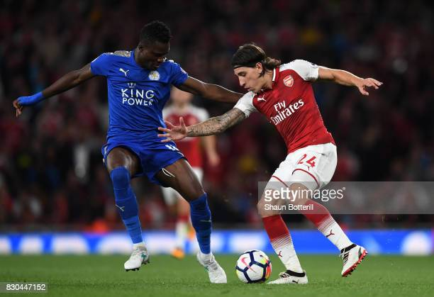 Hector Bellerin of Arsenal is challenged by Daniel Amartey of Leicester City during the Premier League match between Arsenal and Leicester City at...