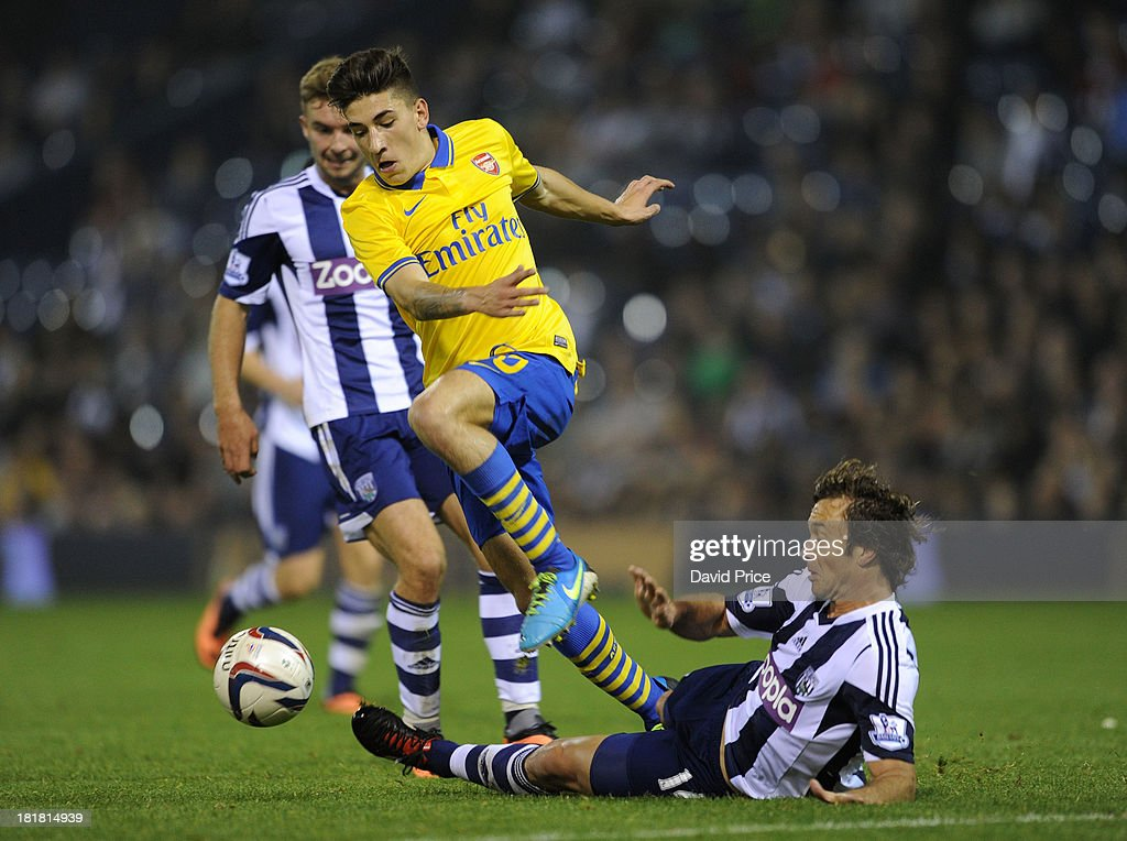 Hector Bellerin of Arsenal is challenged by Diego Lugano of WBA at The Hawthorns on September 25 2013 in West Bromwich England