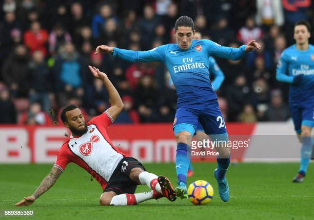 Hector Bellerin of Arsenal is challenged by Ryan Bertrand of Southampton during the Premier League match between Southampton and Arsenal at St Mary's...
