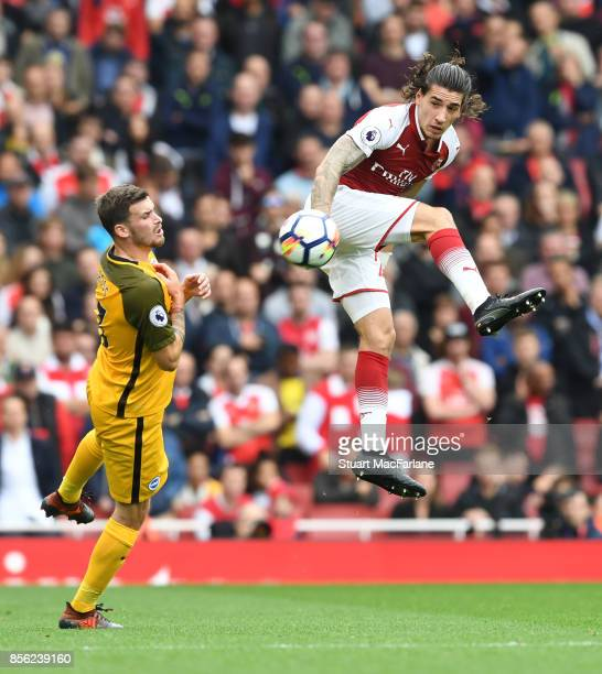 Hector Bellerin of Arsenal outjumps Brighton's Pascal Gross during the Premier League match between Arsenal and Brighton and Hove Albion at Emirates...