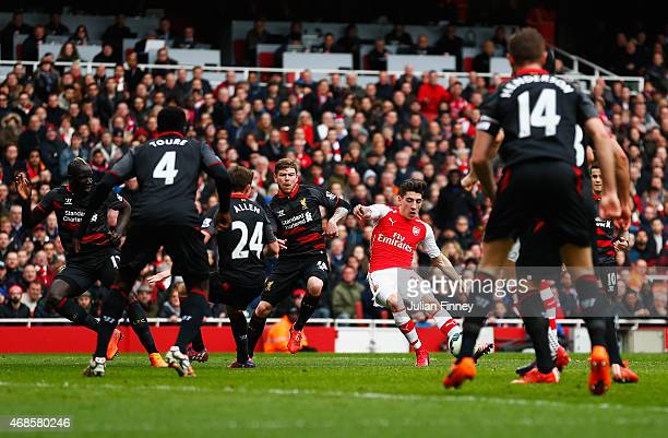 Hector Bellerin of Arsenal scores the opening goal during the Barclays Premier League match between Arsenal and Liverpool at Emirates Stadium on...