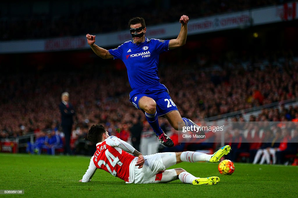 Hector Bellerin of Arsenal slides in on Cesar Azpilicueta of Chelsea during the Barclays Premier League match between Arsenal and Chelsea at Emirates Stadium on January 24, 2016 in London, England.
