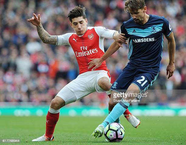 Hector Bellerin of Arsenal tackles Gaston Ramirez of Middlesgrough during the Premier League match between Arsenal and Middlesbrough at Emirates...