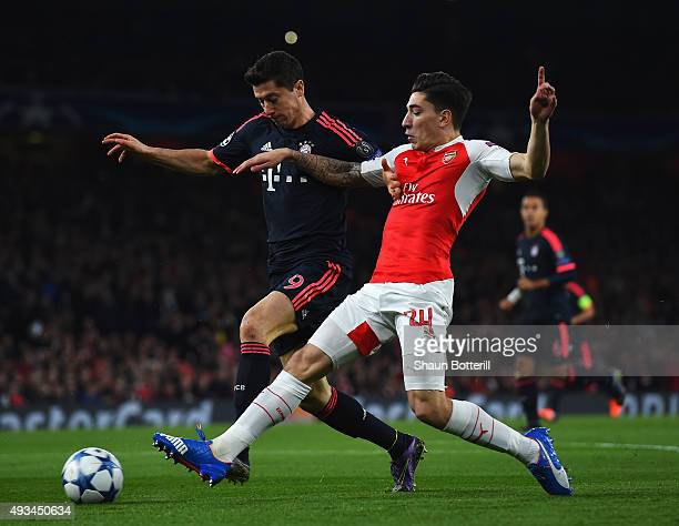 Hector Bellerin of Arsenal tackles Robert Lewandowski of Bayern Munich during the UEFA Champions League Group F match between Arsenal FC and FC...