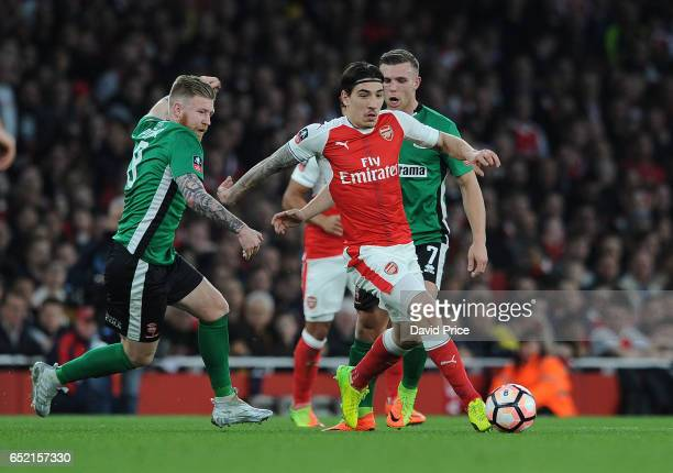 Hector Bellerin of Arsenal takes on Alan Power of Lincoln during the match between Arsenal and Lincoln City at Emirates Stadium on March 11 2017 in...