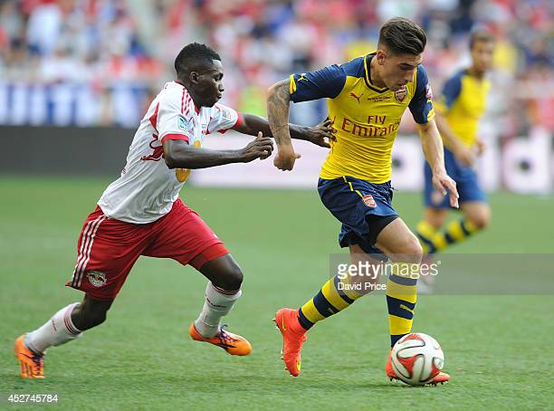 Hector Bellerin of Arsenal takes on Ambroise Oyongo of the New York Red Bulls the pre season match between New York Red Bulls and Arsenal at Red Bull...