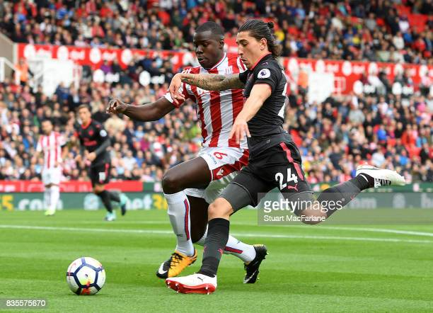 Hector Bellerin of Arsenal takes on Kurt Zouma of Stoke during the Premier League match between Stoke City and Arsenal at Bet365 Stadium on August 19...