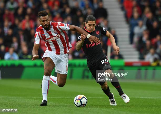 Hector Bellerin of Arsenal takes on Maxim ChoupoMoting of Stoke during the Premier League match between Stoke City and Arsenal at Bet365 Stadium on...