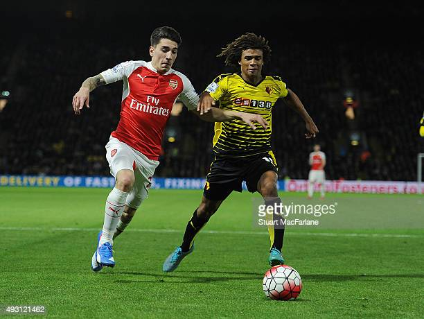 Hector Bellerin of Arsenal takes on Nathan Ake of Watford during the Barclays Premier League match between Watford and Arsenal at Vicarage Road on...