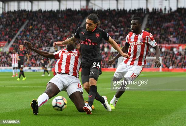 Hector Bellerin of Arsenal tis challenged by Kurt Zouma of Stoke during the Premier League match between Stoke City and Arsenal at Bet365 Stadium on...