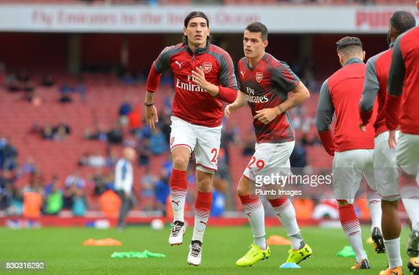 Hector Bellerin of Arsenal warms up at Emirates Stadium ahead of the Premier League match between Arsenal and Leicester City at Emirates Stadium on...