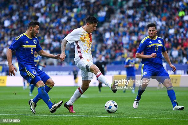 Hector Bellerin of Spain competes for the ball with Sead Kolasinac and Ervin Zukanovic of Bosnia during an international friendly match between Spain...