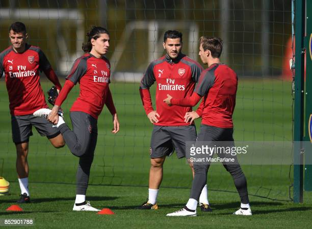 Hector Bellerin Sead Kolasinac and Nacho Monreal of Arsenal during a training session at London Colney on September 24 2017 in St Albans England