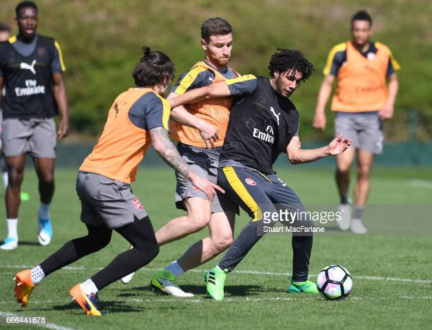 Hector Bellerin Shkodran Mustafi and Mohamed Elneny of Arsenal during a training session at London Colney on April 9 2017 in St Albans England