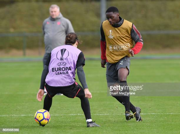 Hector Bellern and Josh Dasilva of Arsenal during a training session at London Colney on November 1 2017 in St Albans England