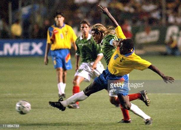 Hector Carabali of Ecuador charges for the ball against Luis Hernandez of Mexico during a friendly game between the two teams in Monterrey Mexico 14...