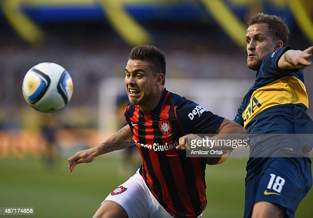 Hector Daniel Villalba of San Lorenzo and Nicolas Colazo figth for the ball during a match between Boca Juniors and San Lorenzo as part of 23rd round...