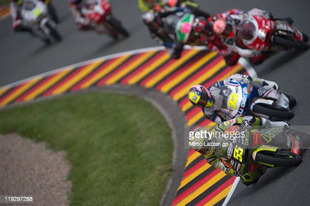 Hector Faubel of Spain and Aspar Team leads the field during the 125 cc race of the MotoGP of Germany at Sachsenring Circuit on July 17 2011 in...