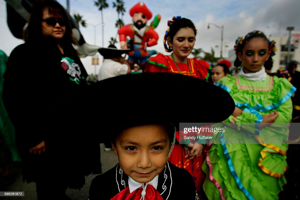 Hector Fernandez waits in line to march down Harbor Blvd during the Pacific Life Holiday Bowl Balloon Parade in San Diego California Arizona and...