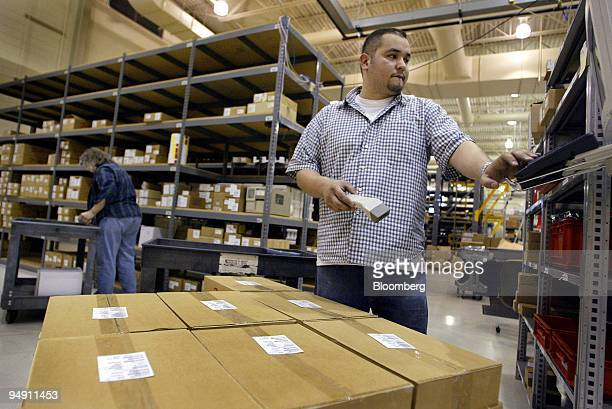 Hector Flores scans barcodes on a load of boxes at the Danfoss Drives manufacturing plant in Rockford Illinois January 6 2004 Danfoss ran just one...